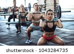 group of sporty muscular people ... | Shutterstock . vector #1043284735