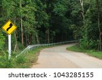 Small photo of road sign warning in forest on country Traffic Signs is ahead of the curve in thailand