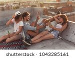 young people chilling out and... | Shutterstock . vector #1043285161