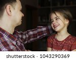 adult father looking with love... | Shutterstock . vector #1043290369