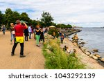 Small photo of COPENHAGEN, DENMARK - JULY 26, 2017: Unidentified people make picture of The Little Mermaid, a bronze statue by Edvard Eriksen, based on the fairy tale by Danish author Hans Christian Andersen
