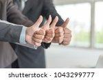 portrait business people giving ... | Shutterstock . vector #1043299777