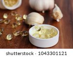 capsules of garlic oil | Shutterstock . vector #1043301121