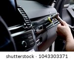car detailing   man holds a... | Shutterstock . vector #1043303371