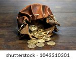 swiss vreneli gold coins in a... | Shutterstock . vector #1043310301