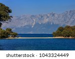 the skorpios island in nidri... | Shutterstock . vector #1043324449
