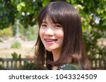 happy woman in nature green... | Shutterstock . vector #1043324509