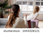 rear view at mother scolding... | Shutterstock . vector #1043328121