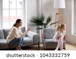 young strict mother or sister... | Shutterstock . vector #1043332759