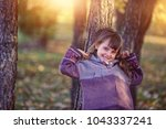 portrait of a young girl in park | Shutterstock . vector #1043337241