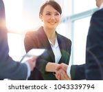 businesswoman shaking hands... | Shutterstock . vector #1043339794
