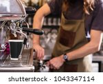 barista is making coffee | Shutterstock . vector #1043347114