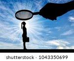 silhouette of an employee woman.... | Shutterstock . vector #1043350699