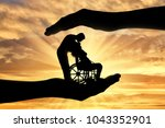 silhouettes of a happy disabled ... | Shutterstock . vector #1043352901