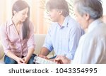 doctor with patient in hospital | Shutterstock . vector #1043354995
