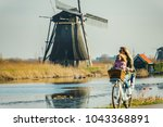mother and sons biking in the... | Shutterstock . vector #1043368891