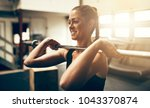 fit young woman in sportswear... | Shutterstock . vector #1043370874