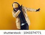 african american man in yellow... | Shutterstock . vector #1043374771