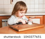 little baby girl cuts onions on ...