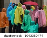 a group of people in colorful... | Shutterstock . vector #1043380474