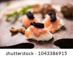 canapes with smoked salmon and... | Shutterstock . vector #1043386915