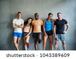 smiling group of friends in... | Shutterstock . vector #1043389609