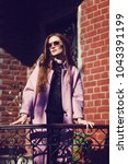 portrait of young girl wearing...   Shutterstock . vector #1043391199