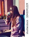 woman in coat drinking coffee...   Shutterstock . vector #1043391229