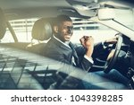 young african businessman in a... | Shutterstock . vector #1043398285