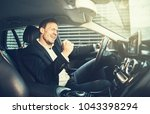 young businessman in a blazer... | Shutterstock . vector #1043398294