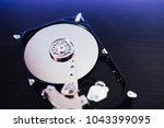 disassembled hard drive from... | Shutterstock . vector #1043399095