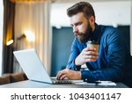 young serious bearded... | Shutterstock . vector #1043401147