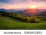 pink sunset over the mountains... | Shutterstock . vector #1043411851