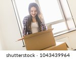 woman packing and unpacking... | Shutterstock . vector #1043439964