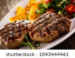 grilled beefsteak with french... | Shutterstock . vector #1043444461