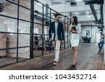 happy business partners. full... | Shutterstock . vector #1043452714