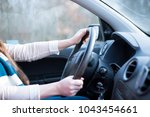 young woman driving her new car ... | Shutterstock . vector #1043454661