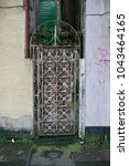 old and oxide metal door | Shutterstock . vector #1043464165