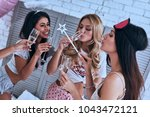 private party. four attractive... | Shutterstock . vector #1043472121