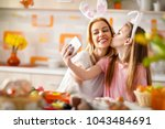 daughter kiss her mother on... | Shutterstock . vector #1043484691