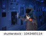 engineer wear a arc flash... | Shutterstock . vector #1043485114