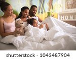 afro  american family together... | Shutterstock . vector #1043487904
