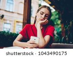 sad hipster girl browsing... | Shutterstock . vector #1043490175