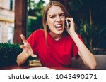 portrait of angry young woman... | Shutterstock . vector #1043490271