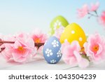 colorful easter eggs and flowers | Shutterstock . vector #1043504239
