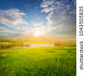 small lake coast at the sunset... | Shutterstock . vector #1043505835