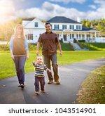 happy mixed race family walking ... | Shutterstock . vector #1043514901
