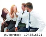 colleagues giving each other... | Shutterstock . vector #1043516821