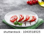 tomatoes  mozzarella cheese ... | Shutterstock . vector #1043518525
