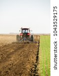 Small photo of Farmer in tractor preparing land with seedbed cultivator as part of pre seeding activities in early spring season of agricultural works at farmlands.
